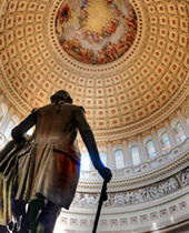 Capitol dome with bronze statue